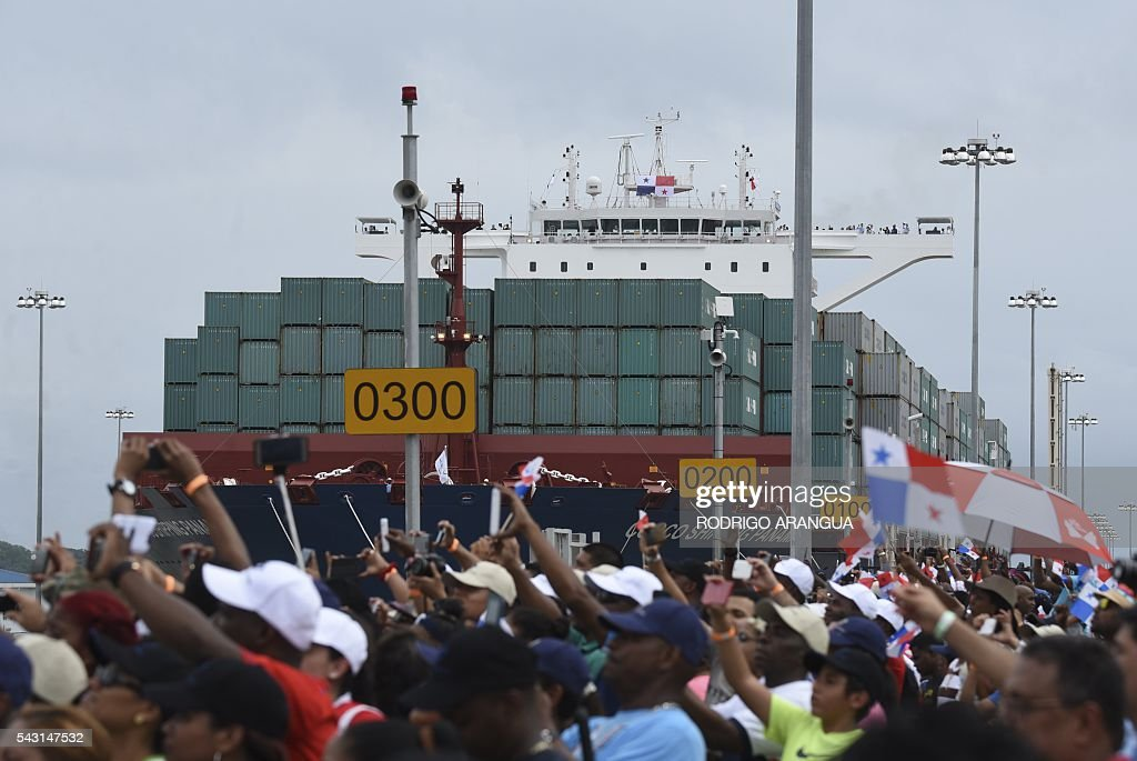 Chinese-chartered merchant ship Cosco Shipping Panama crosses the new Agua Clara Locks during the inauguration of the expansion of the Panama Canal in Colon, 80 km from Panama City on June 26, 2016 on June 26, 2016. A giant Chinese-chartered freighter nudged its way into the expanded Panama Canal on Sunday to mark the completion of nearly a decade of work forecast to boost global trade. / AFP / RODRIGO