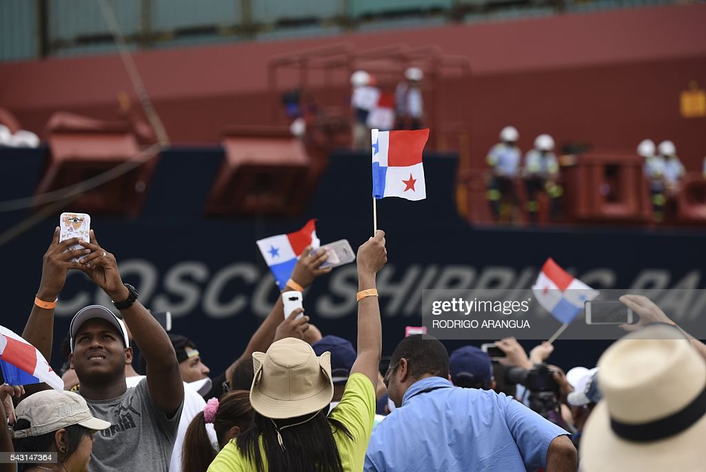 Chinese-freighted merchant ship Cosco Shipping Panama crosses the new Agua Clara Locks during the inauguration of the expansion of the Panama Canal in Colon, 80 km from Panama City on June 26, 2016 on June 26, 2016. A giant Chinese-chartered freighter nudged its way into the expanded Panama Canal on Sunday to mark the completion of nearly a decade of work forecast to boost global trade. / AFP / RODRIGO