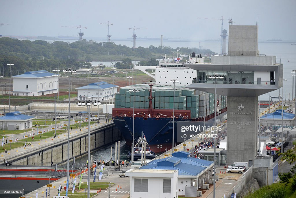 Chinese-freighted merchant ship Cosco Shipping Panama crosses the new Agua Clara Locks during the inauguration of the expansion of the Panama Canal in Colon, 80 km from Panama City on June 26, 2016 on June 26, 2016. A giant Chinese-chartered freighter nudged its way into the expanded Panama Canal on Sunday to mark the completion of nearly a decade of work forecast to boost global trade. / AFP / JOHAN