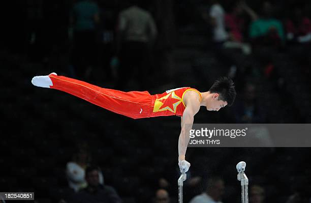 Chinese's Shixiong Zhou competes during the parallel bars event of the 44th Artistic Gymnastics World Championships on September 30 2013 in Antwerp...