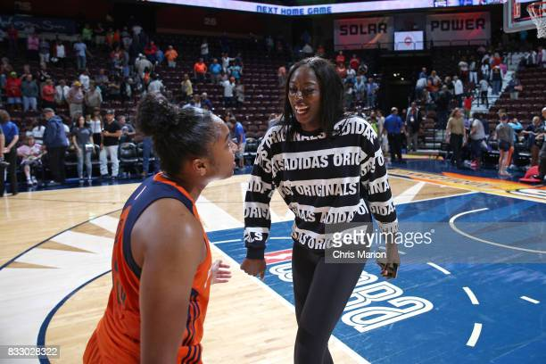 Chiney Ogwumike and Alex Bentley of the Connecticut Sun celebrate a win against the Dallas Wings on August 12 2017 at Mohegan Sun Arena in Uncasville...
