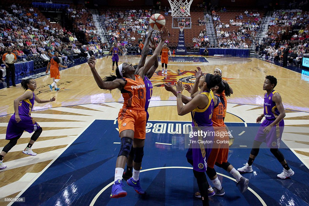 Chiney Ogwumike #13 of the Connecticut Sun challenges for the rebound during the Los Angeles Sparks Vs Connecticut Sun, WNBA regular season game at Mohegan Sun Arena on May 26, 2016 in Uncasville, Connecticut.