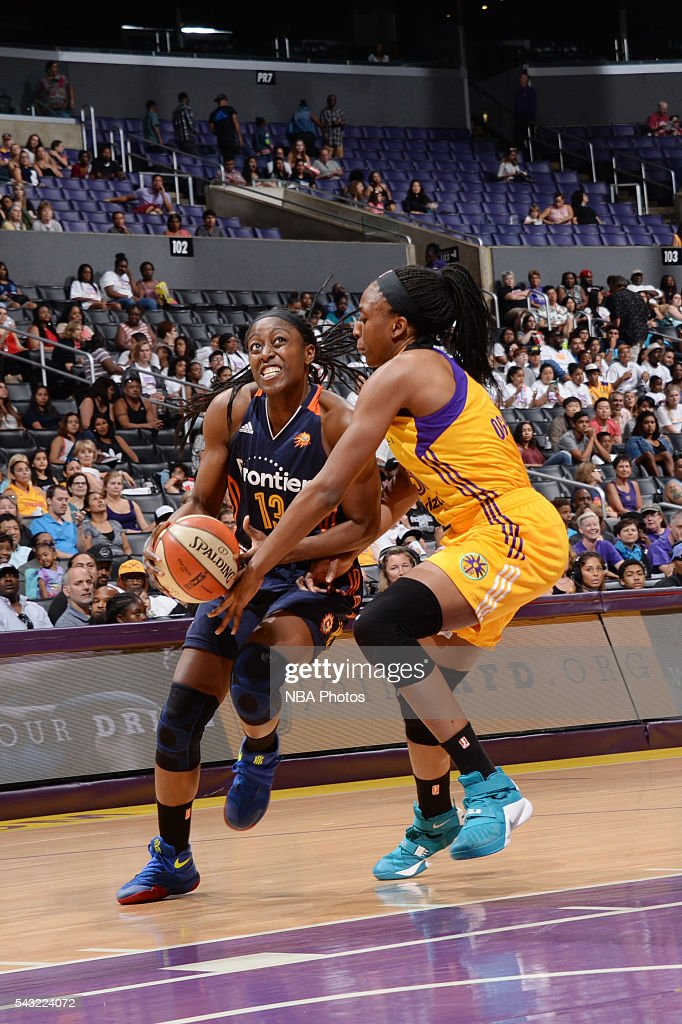 <a gi-track='captionPersonalityLinkClicked' href=/galleries/search?phrase=Chiney+Ogwumike&family=editorial&specificpeople=6866662 ng-click='$event.stopPropagation()'>Chiney Ogwumike</a> #13 of the Connecticut Sun drives to the basket against <a gi-track='captionPersonalityLinkClicked' href=/galleries/search?phrase=Nneka+Ogwumike&family=editorial&specificpeople=7950576 ng-click='$event.stopPropagation()'>Nneka Ogwumike</a> #30 of the Los Angeles Sparks on June 26, 2016 at STAPLES Center in Los Angeles, California.