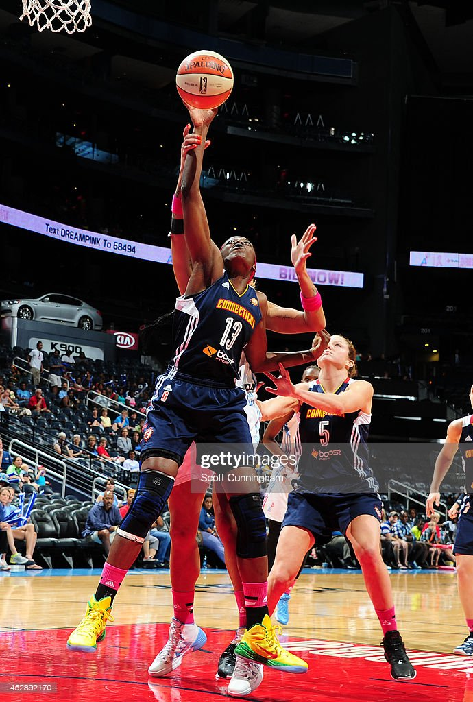 Chiney Ogwumike #13 of the Connecticut Sun grabs a rebound against the Atlanta Dream on July 29, 2014 at Philips Arena in Atlanta, Georgia.