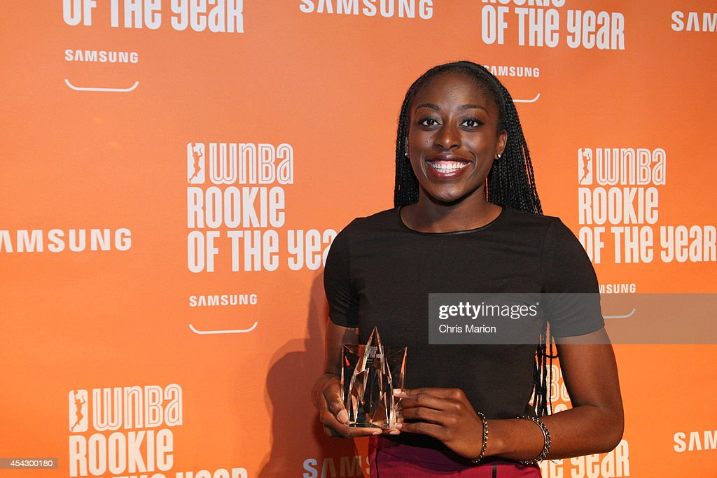 Chiney Ogwumike of the Connecticut Sun poses with the 2014 WNBA Rookie Of The Year Award at a press conference on August 28, 2014 at the Mohegan Sun Casino in Uncasville, Connecticut.