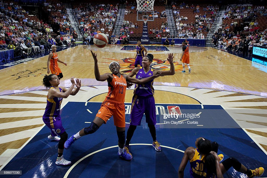 Chiney Ogwumike #13 of the Connecticut Sun rebounds during the Los Angeles Sparks Vs Connecticut Sun, WNBA regular season game at Mohegan Sun Arena on May 26, 2016 in Uncasville, Connecticut.