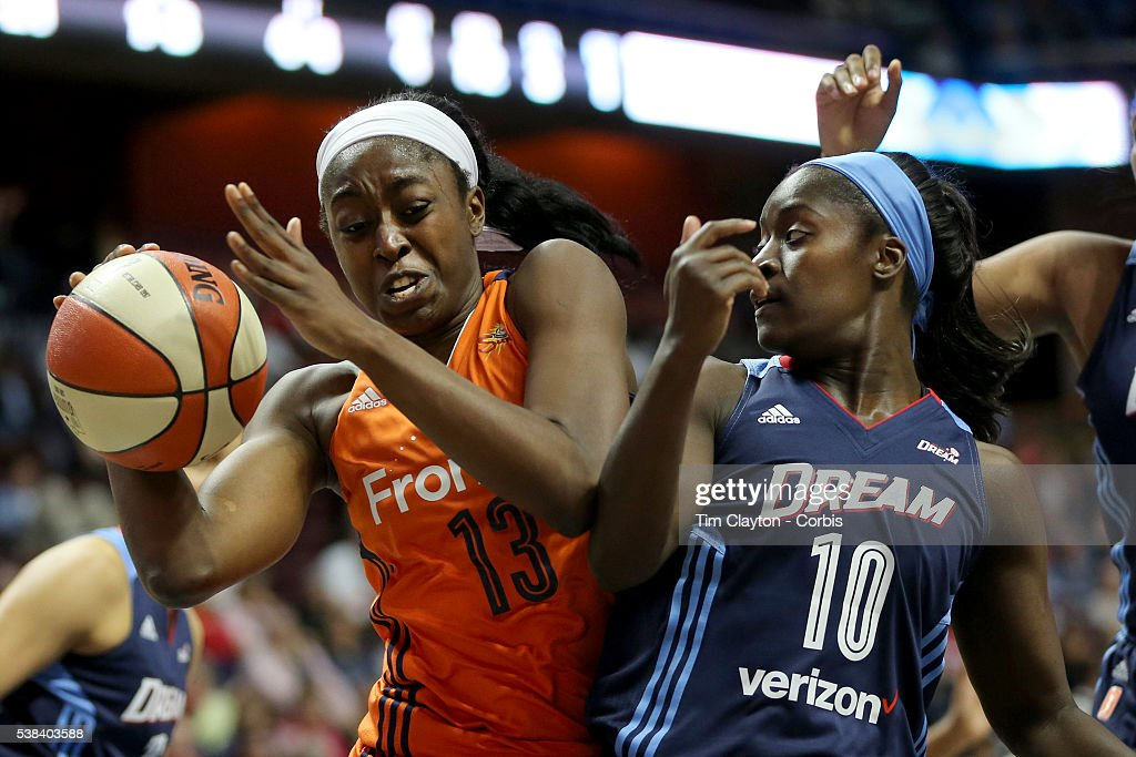 Chiney Ogwumike of the Connecticut Sun rebounds while challenged by Matee Ajavon of the Atlanta Dream during the Atlanta Dream Vs Connecticut Sun...