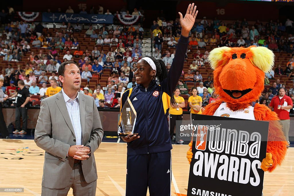 Chiney Ogwumike #13 of the Connecticut Sun receives the Rookie of the Month award for June prior to a game at the Mohegan Sun Arena on July 13, 2014 in Uncasville, Connecticut.