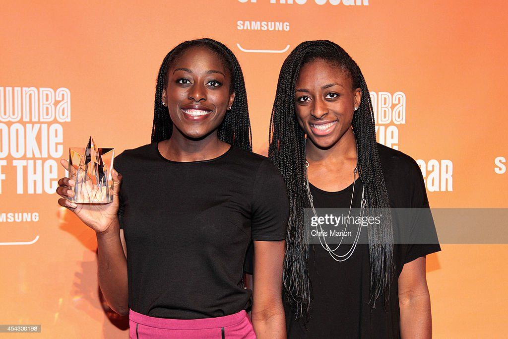 Chiney Ogwumike poses with her sister Nneka Ogwumike and the 2014 WNBA Rookie Of The Year Award that was presented to Chiney at a press conference on August 28, 2014 at the Mohegan Sun Casino in Uncasville, Connecticut.