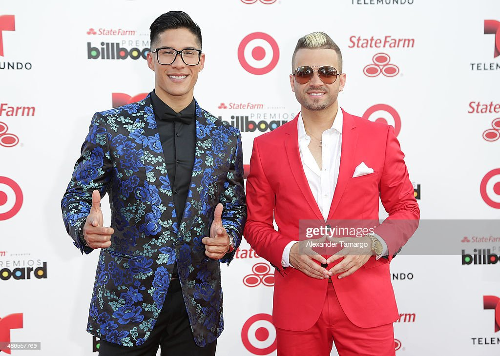 Chino and Nacho arrive at the 2014 Billboard Latin Music Awards at Bank United Center on April 24, 2014 in Miami, Florida.