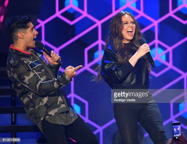 Chino Miranda and Joy Uecke present an award during Univision's 'Premios Juventud' 2017 Celebrates The Hottest Musical Artists And Young Latinos...