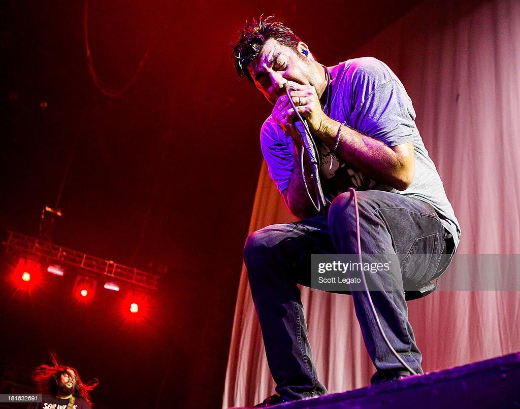 Chino Moreno of the Deftones performs at Joe Louis Arena on October 13, 2013 in Detroit, Michigan.