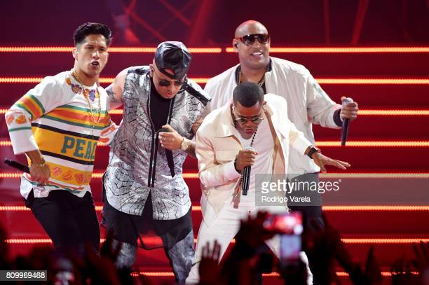 Chino Wisin and Gente De Zona perform on stage during Univision's 'Premios Juventud' 2017 Celebrates The Hottest Musical Artists And Young Latinos...