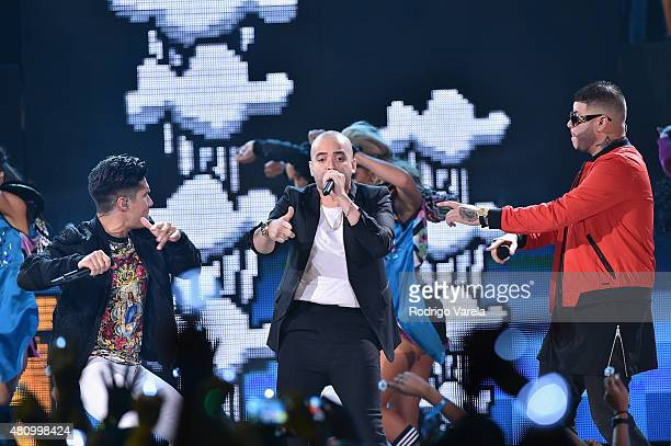 Chino Y Nacho and Farruko perform onstage at Univision's Premios Juventud 2015 at Bank United Center on July 16 2015 in Miami Florida