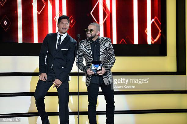 Chino y Nacho onstage at Telemundo's Premios Tu Mundo 'Your World' Awards at American Airlines Arena on August 25 2016 in Miami Florida