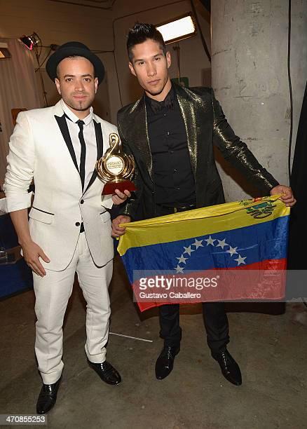 Chino Y Nacho pose backstage at Premio Lo Nuestro a la Musica Latina 2014 at American Airlines Arena on February 20 2014 in Miami Florida