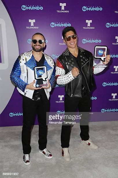 Chino y Nacho pose with awards at Telemundo's Premios Tu Mundo 'Your World' Awards at American Airlines Arena on August 25 2016 in Miami Florida