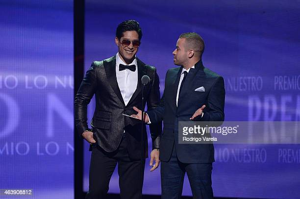 Chino y Nacho speak onstage at the 2015 Premios Lo Nuestros Awards at American Airlines Arena on February 19 2015 in Miami Florida