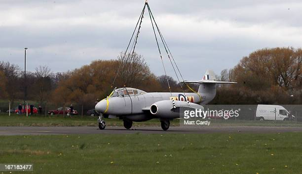 Chinock helicopter moves a historic Gloster Meteor T7 jet to its new home at the Jet Age Museum which is based at Gloucestershire Airport in...