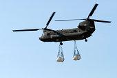 A CH-47 Chinook carrying sandbags.