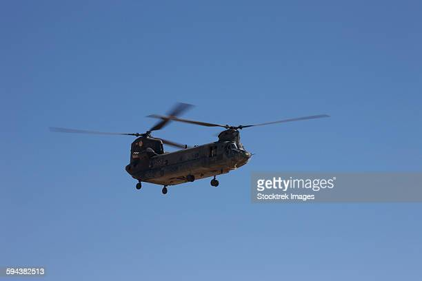 CH-47 Chinook flies over Playas Training Area, New Mexico during exercise Angel Thunder 2013.