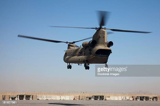 A CH-47 Chinook helicopter prepare to land.