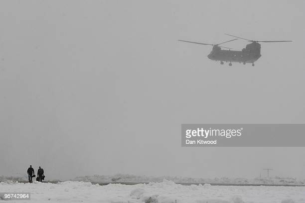 Chinook helicopter takes off in deep snow at RAF Odiham on January 13 2010 in Odiham England Two of the eight new Chinook Mk3 helicopters that are to...