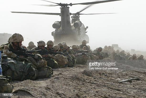Chinook helicopters from 18 Squadron insert British Marines from 40 Commando April 6 2003 into the southern Iraqi city of Basra British tanks stormed...