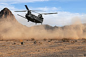 October 10, 2009 - Marines are covered in desert dust as they wait for an Army CH-47 Chinook to land on the Barry M. Goldwater Range east of the Marine Corps Air Station in Yuma, Arizona. The Marines