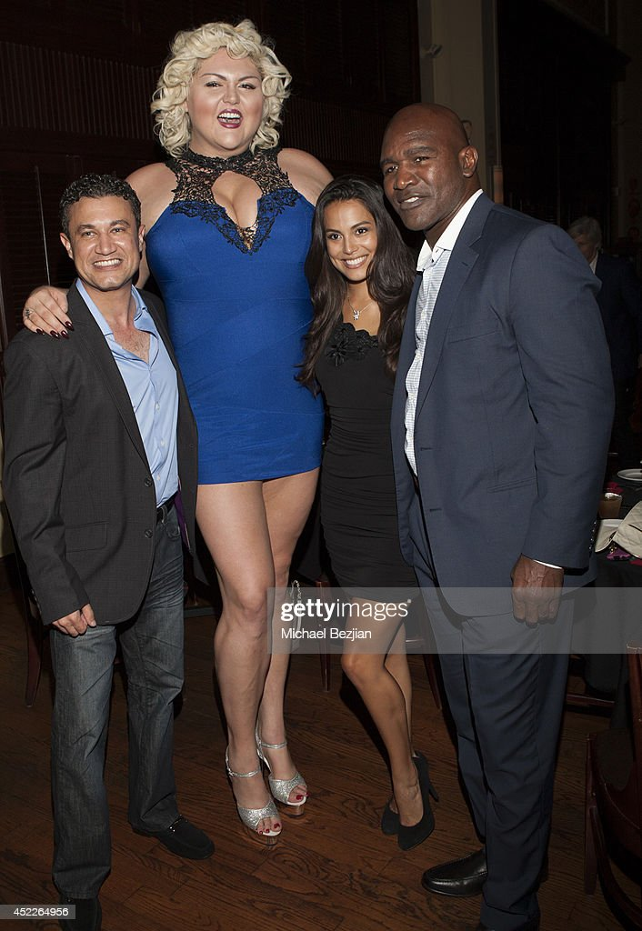 Chintan Gandhi, Lindsay Hayward, Raquel Pomplun, and Evander Holyfield attend PREFUNC At The Celebrity Sweat VIP Party at The Palm on July 16, 2014 in Los Angeles, California.