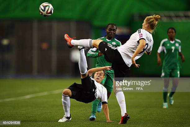 Chinwendu Ihezuo of Nigeria is challenged by Felicitas Rauch and Rebecca Knaak of Germany during the FIFA U20 Women's World Cup Canada 2014 final...