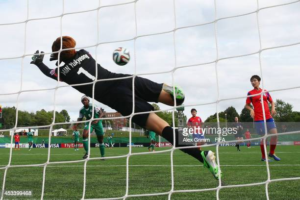 Chinwendu Ihezuo of Nigeria scores her team's second goal against goalkeeper Min Yukyeong of Korea Republic during the FIFA U20 Women's World Cup...