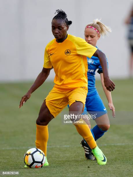 Chinwendu Ihezuo of WFC BIIKKazygurt covers the ball from Zsuzsanna Szabo of MTK Hungaria FC during the UEFA Women's Champions League Qualifying...