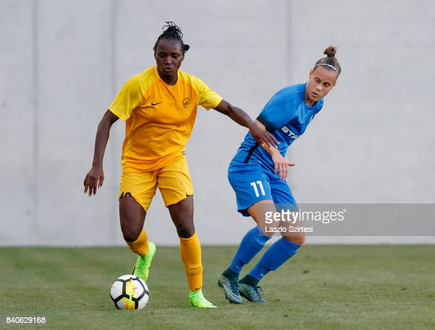 Chinwendu Ihezuo of WFC BIIKKazygurt leaves Dora Papp of MTK Hungaria FC behind during the UEFA Women's Champions League Qualifying match between MTK...