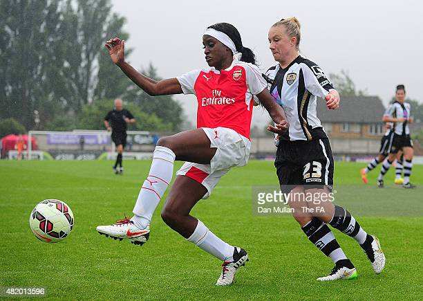 Chioma Ubogagu of Arsenal holds off Laura Bassett of Notts County during the WSL match between Arsenal Ladies and Notts County Ladies at Meadow Park...
