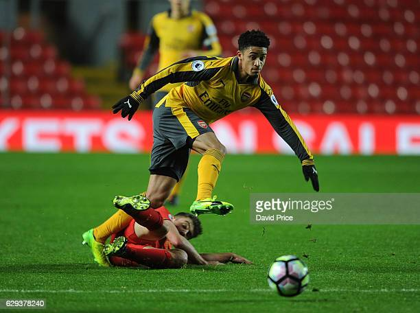 Chiori Johnson of Arsenal is challenged by Cameron Brannagan of Liverpool during the Premier League match between Arsenal and Stoke City at Anfield...