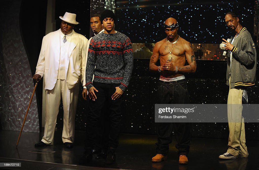 Chip (formerly Chipmunk) (C) attends a photocall to unveil wax figures of rap stars Biggie Smalls (aka The Notorious BIG) (L), P Diddy (2nd L), Tupac Shakur (2nd R) and Snoop Dogg (R), exhibited for the first time together in London at Madame Tussauds on January 14, 2013 in London, England.