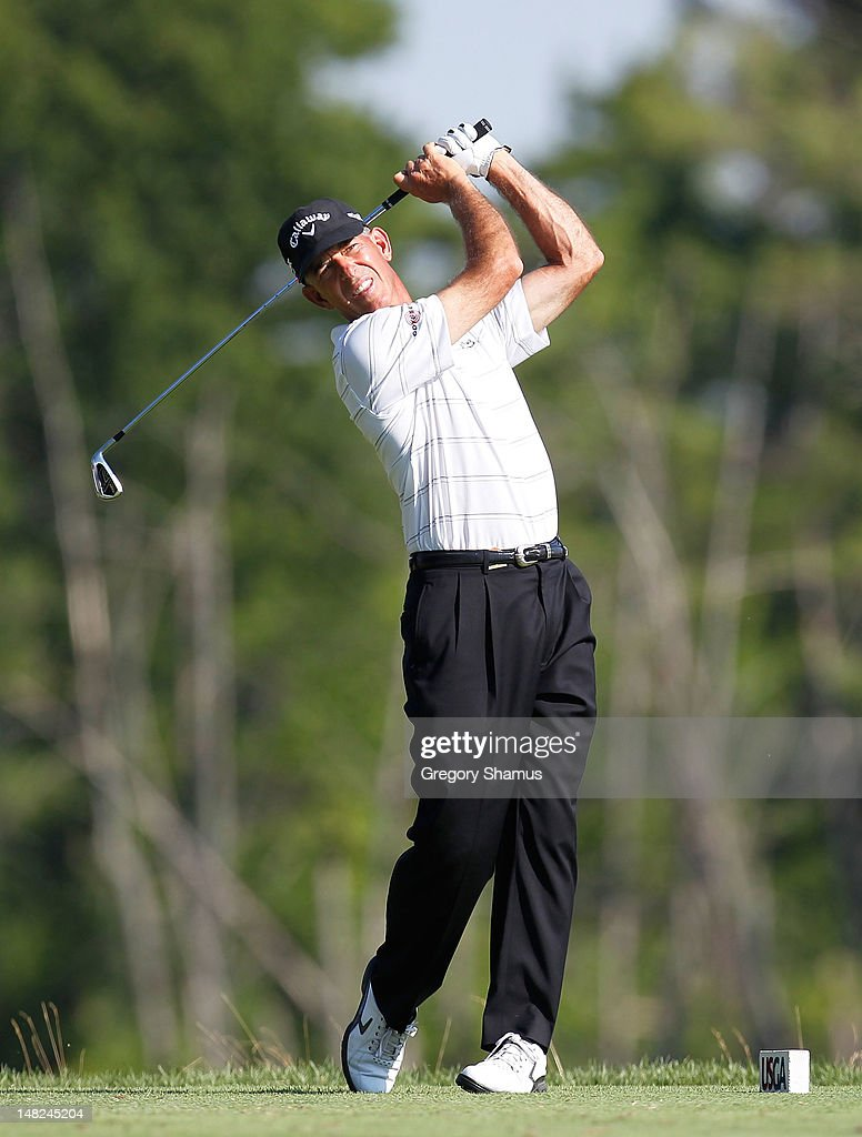 <a gi-track='captionPersonalityLinkClicked' href=/galleries/search?phrase=Chip+Beck&family=editorial&specificpeople=2536314 ng-click='$event.stopPropagation()'>Chip Beck</a> watches his tee shot on the ninth hole during the first round of the 2012 Senior United States Open at Indianwood Golf and Country Club on July 12, 2012 in Lake Orion, Michigan.