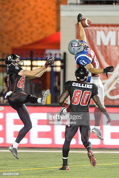 Chip Cox of the Montreal Alouettes intercepts a pass intended for Onrea Jones of the Ottawa Redblacks during the CFL game at Percival Molson Stadium...