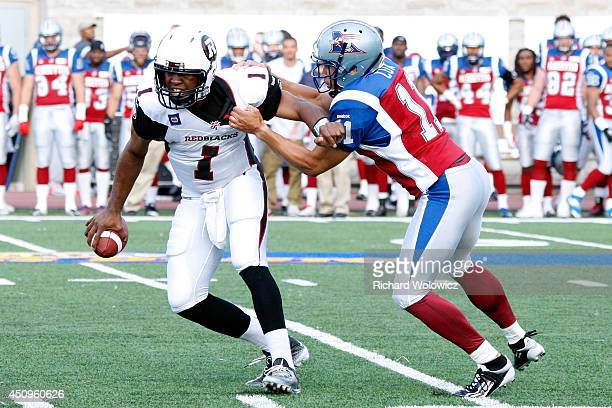 Chip Cox of the Montreal Alouettes sacks Henry Burris of the Ottawa Redblacks during the CFL game at Percival Molson Stadium on June 20 2014 in...