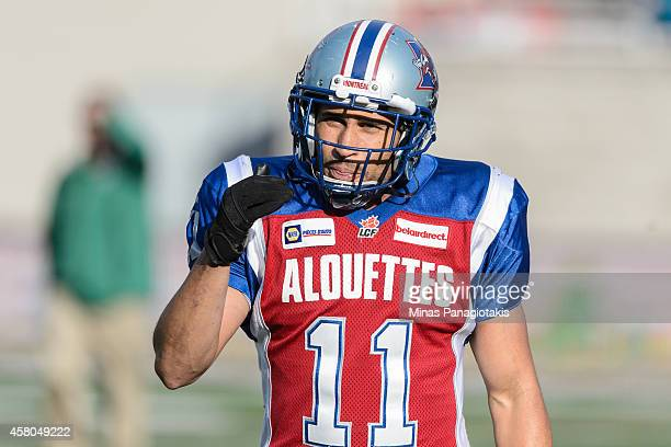 Chip Cox of the Montreal Alouettes walks towards teammates during the CFL game against the Saskatchewan Roughriders at Percival Molson Stadium on...