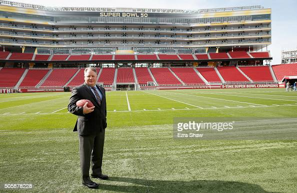 Chip Kelly stands on the field after a press conference where he was announced as the new head coach of the San Francisco 49ers at Levi's Stadium on...