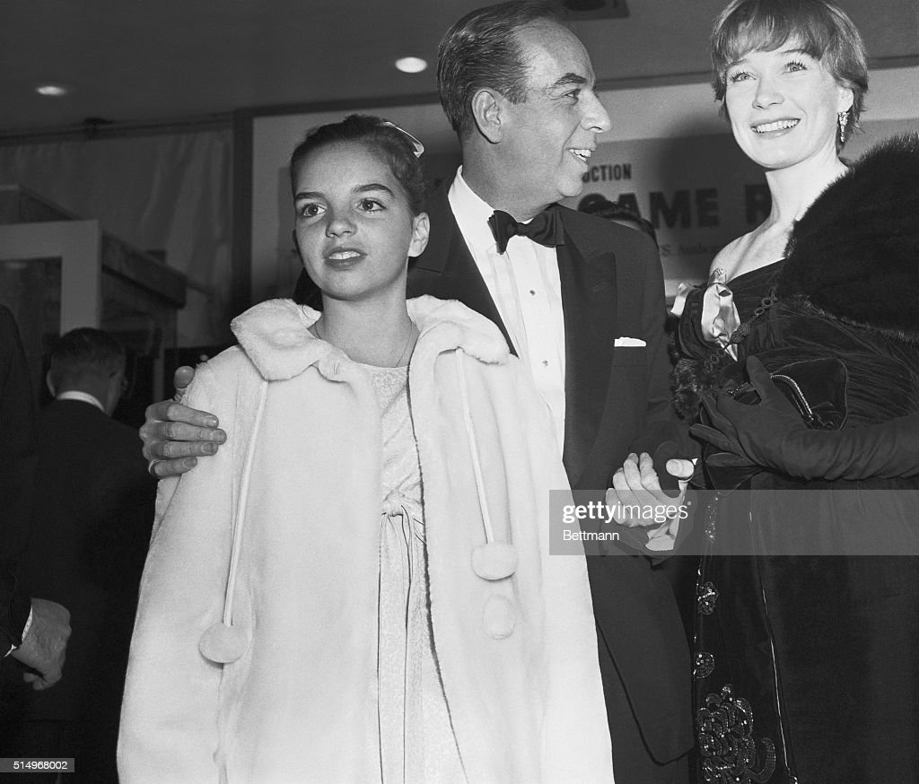 Bearing a strong resemblance to her mother, Judy Garland, 12-year-old <a gi-track='captionPersonalityLinkClicked' href=/galleries/search?phrase=Liza+Minnelli&family=editorial&specificpeople=121547 ng-click='$event.stopPropagation()'>Liza Minnelli</a> arrives at a Hollywood premiere with her father, director Vincent Minnelli, Judy's ex-husband. They were at the Paramount Hollywood Theater for the premiere of Some Came Running, made from James Jones' mammoth novel.