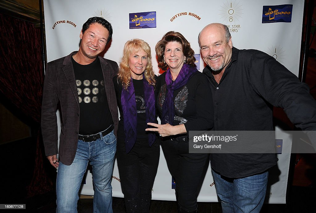 Chip Schutzman, author and photographer Lisa Johnson, Sheryl Northrop and Jeff Albright attend the book launch and performance for '108 Rock Star Guitars' benefitting The Les Paul Foundation at The Cutting Room on October 8, 2013 in New York City.