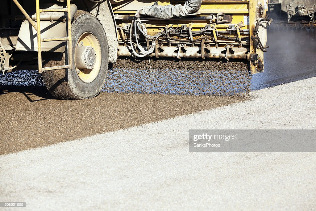 Chip Sealing Asphalt Pavement Street with Crushed Rock : Stock Photo