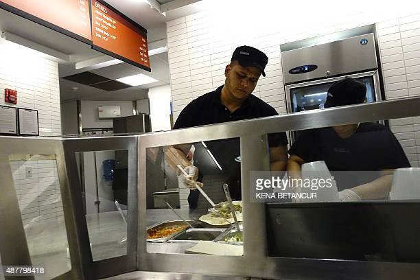 Chipotle employee prepares food in Manhattan on September 11 2015 in New York Chipotle's 1850 restaurants spent September 9 2015 in a cram effort to...
