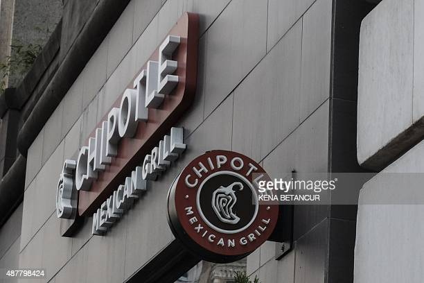 A Chipotle restaurant sign is seen in Manhattan on September 11 2015 in New York Chipotle's 1850 restaurants spent September 9 2015 in a cram effort...