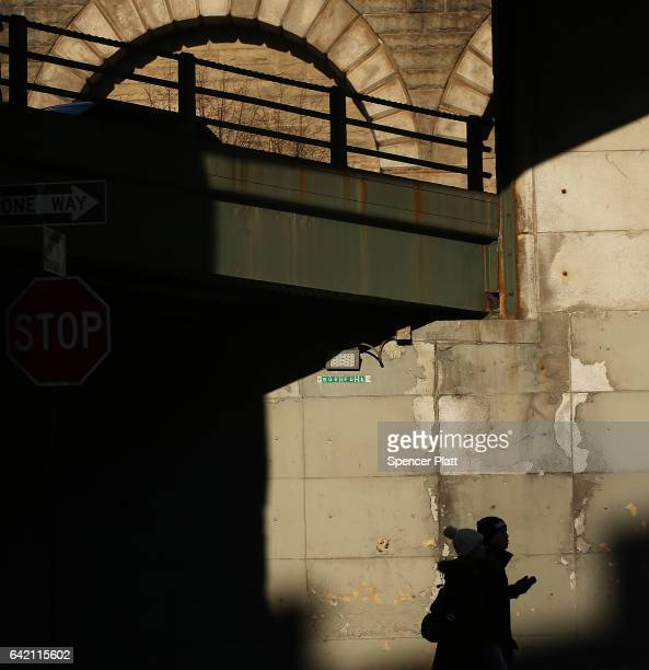 A chipped and damaged wall stands under a bridge in Brooklyn on February 16 2017 in New York City An annual report by the American Road and...