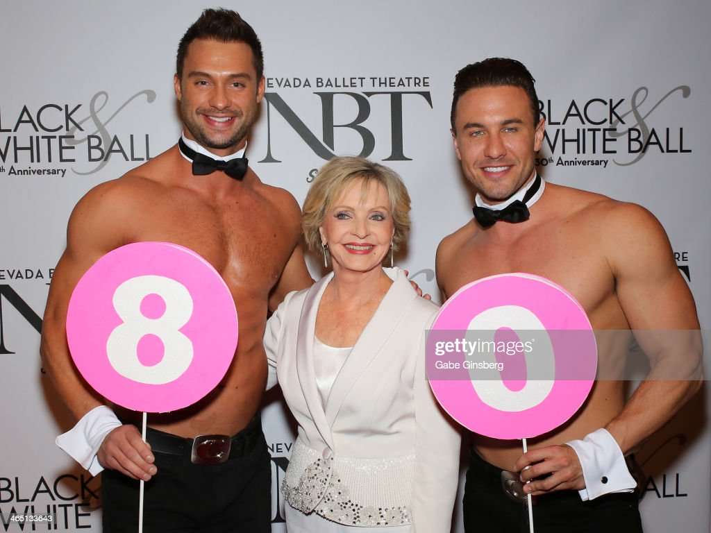 Chippendales dancer James Davis, actress <a gi-track='captionPersonalityLinkClicked' href=/galleries/search?phrase=Florence+Henderson&family=editorial&specificpeople=171392 ng-click='$event.stopPropagation()'>Florence Henderson</a> and Chippendales dancer Ryan Stuart hold up signs to mark Henderson's 80th birthday at Nevada Ballet Theatre presents 'The Black & White Ball's 30th Anniversary' at the Aria Resort & Casino at CityCenter on January 25, 2014 in Las Vegas, Nevada.