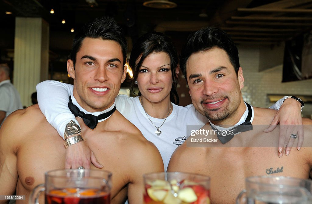 Chippendales dancer Jon Howes, chef Carla Pellegrino and Chippendales dancer Juan DeAngelo appear at the meatball eating contest at the Meatball Spot on March 16, 2013 in Las Vegas, Nevada.